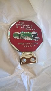 LOT 3: R&ERPS metal car badge. Mint condition but damaged box.